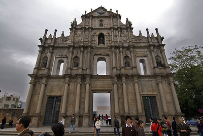 Tourists exploring outside the St. Paul's Facade in Macau