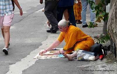 "I didn't really know what to make of this woman. Obviously religious, but selling crafts outside the main Batu area, and looking a little rough around the edges. Often I would see ""monks"" asking for money in shopping centres. I'm not religious, but still found it uncomfortable."
