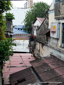 Peering into the disrepair beyond the facades. Nothing like Bangkok though.