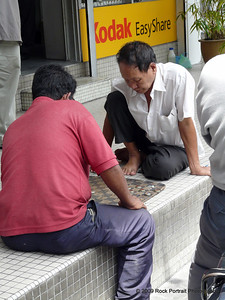 A regular theme throughout Asia was seeing people playing board games on the street. This time it's checkers with bottle tops.