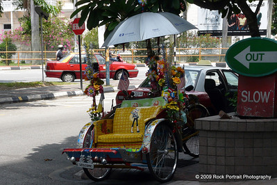 One of Penang's more attractive trikes. These also serve as homes for their riders.