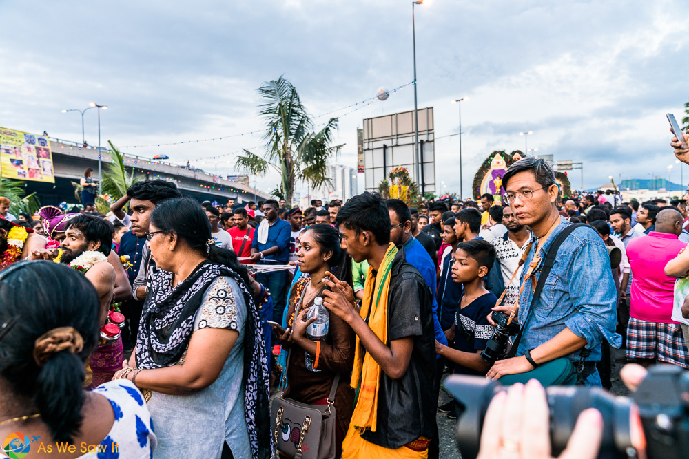Photographer moving along with the crowd in respect of the faithful. Thaipusam 2017