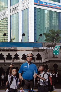 Nice poster close to the Petronas Towers. Notice the life scene at the bottom which nicely adds a scale, dynamics and ultimately life to the capture.