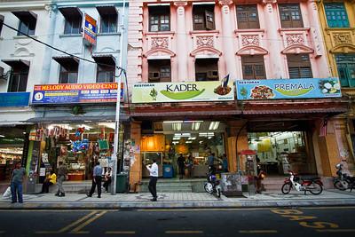 Colorful street life scene in Kuala Lumpur.