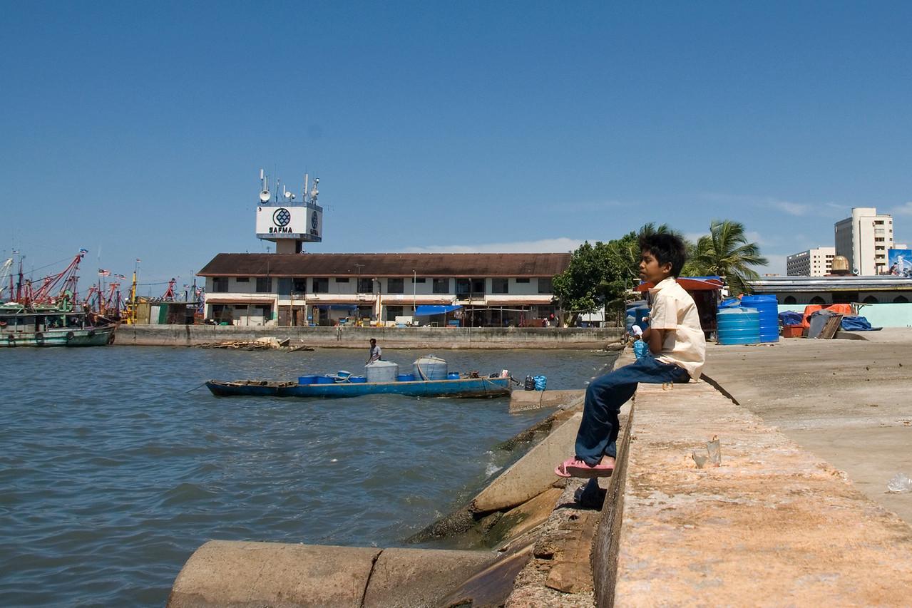 Child sitting on the Dock of the Bay - Kota Kinabalu, Sabah, Malaysia