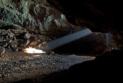 Beam of light hitting the grounds inside the cave at Mulu National Park - Sarawak, Malaysia