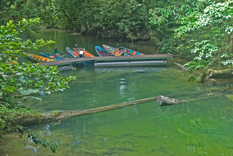 Long boats docked on bridge at Mulu National Park - Sarawak, Malaysia