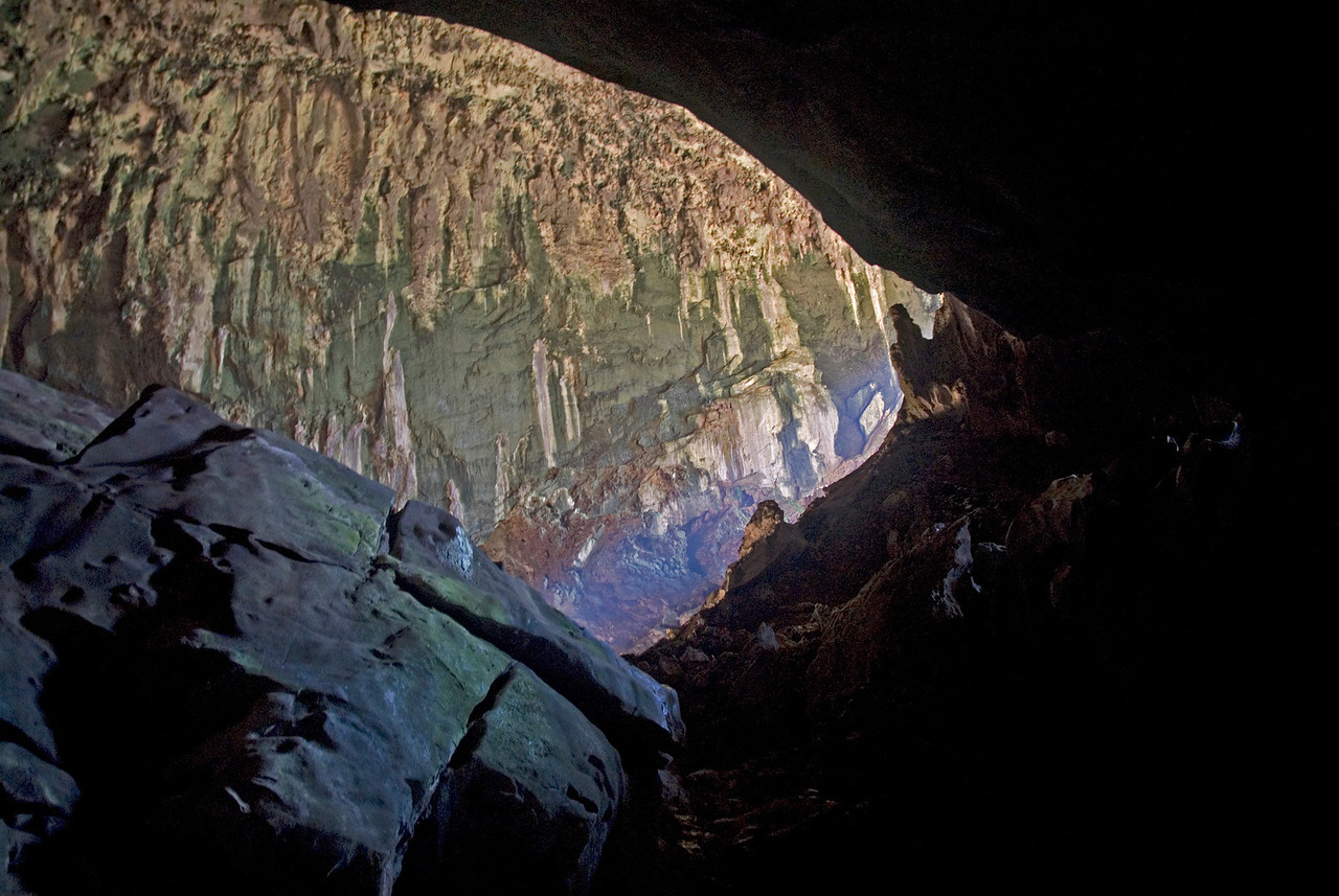 Streaks of sunlight beaming from outside on the wall of Deer Cave, Mulu National Park - Sarawak, Malaysia