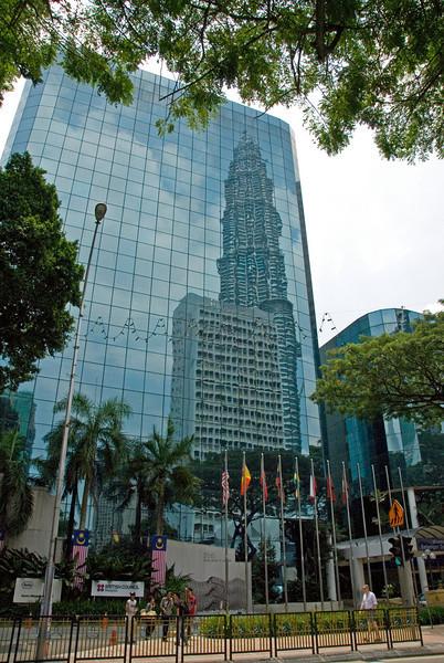 Petronas Tower Reflection on another skyscraper in Kuala Lumpur, Malaysia