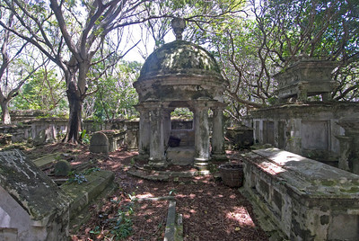 Shot of the ruined tombs and arc inside the Protestant Cemetery Grounds - Penang, Malaysia