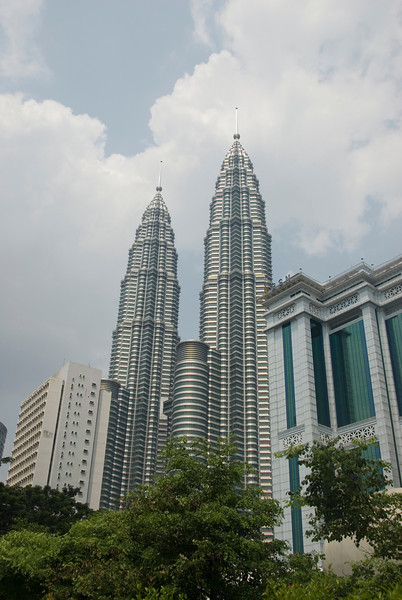 Petronas Towers surrounded by other tall towers in Kuala Lumpur, Malaysia
