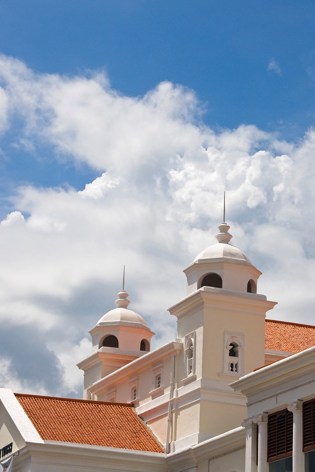 Twin towers hovering above building against clear sky in George Town, Penang, Malaysia