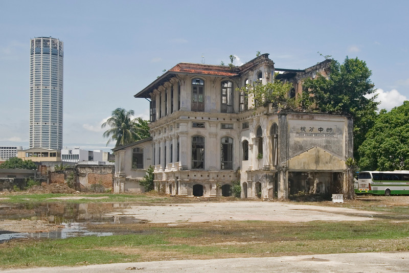 Shot of the Colonial Building with a skyscraper in the background - George Town, Penang, Malaysia