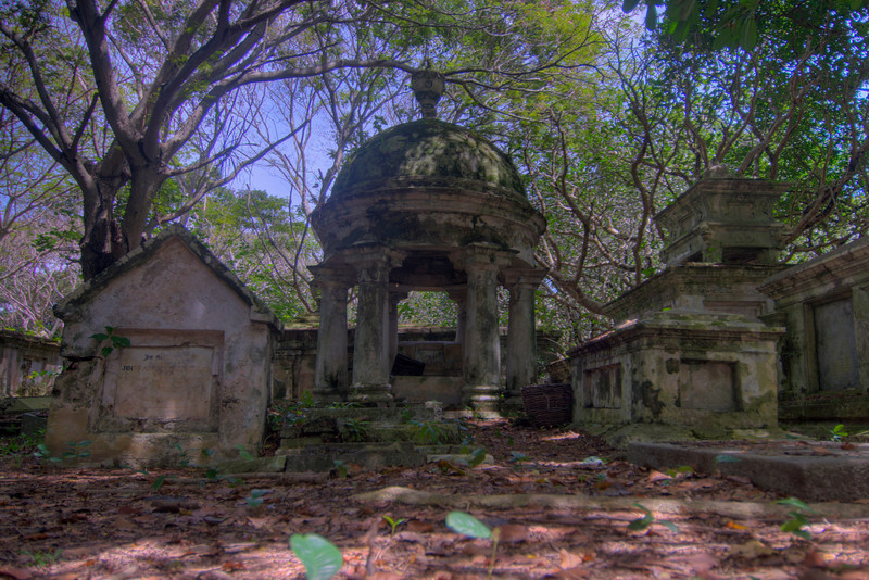 Ruins and moss covered tombs within the Protestant Cemetary - Penang, Malaysia