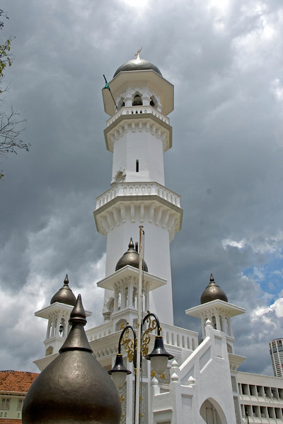 Overlooking shot of minarets on mosque with storm clouds on sky - George Town, Penang, Malaysia