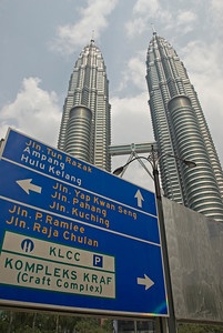 Traffic sign with Petronas Towers in the background - Kuala Lumpur, Malaysia