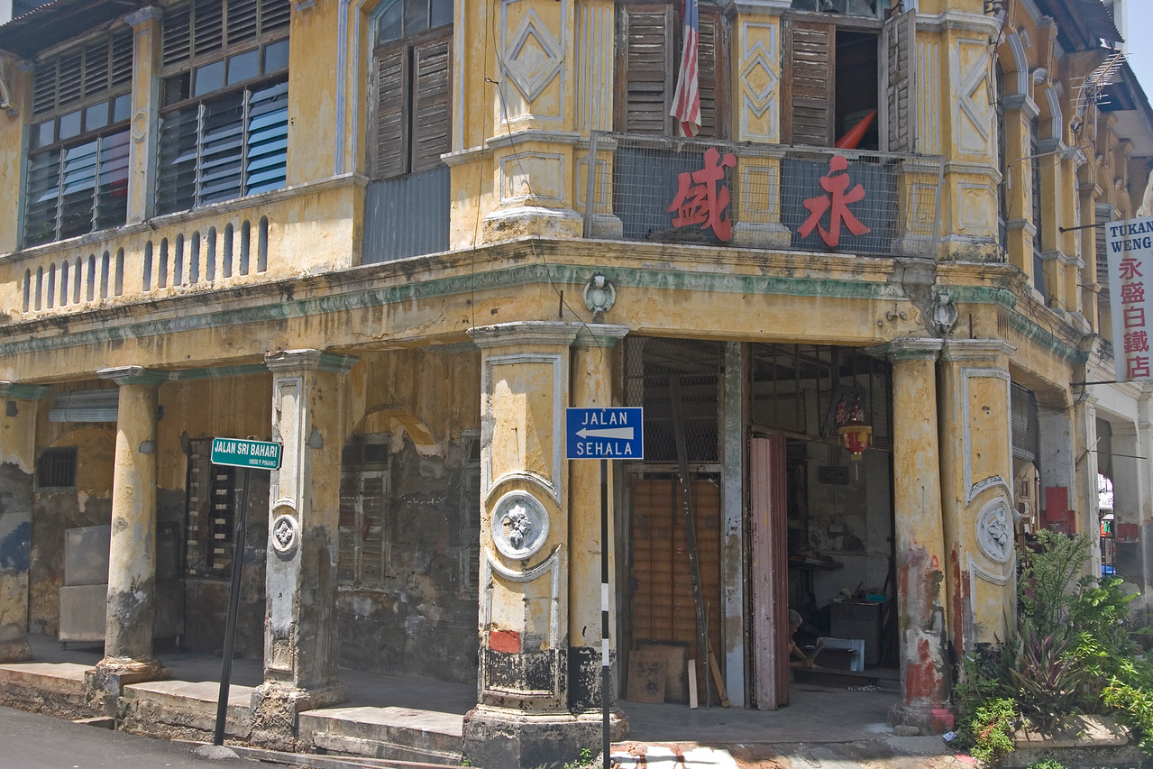 Dilapidated facade of an old colonial building in George Town, Penang, Malaysia