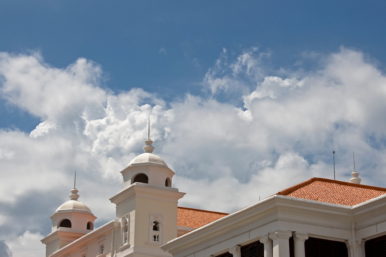 Beautiful white clouds atop a building in George Town, Penang, Malaysia