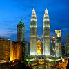 The Petronas Towers dominate the Kuala Lumpur City Center (KLCC) skyline.