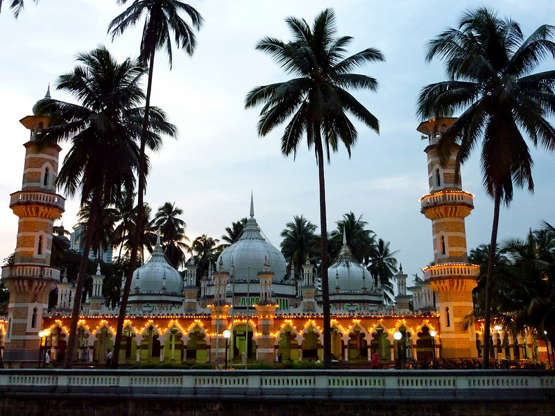Masjid Jamek (or Jamek Mosque) is one of the oldest mosques in Kuala Lumpur, Malaysia.  The mosque is located at the confluence of two rivers and is nestled in palm trees.  This photo was taken as evening approached.