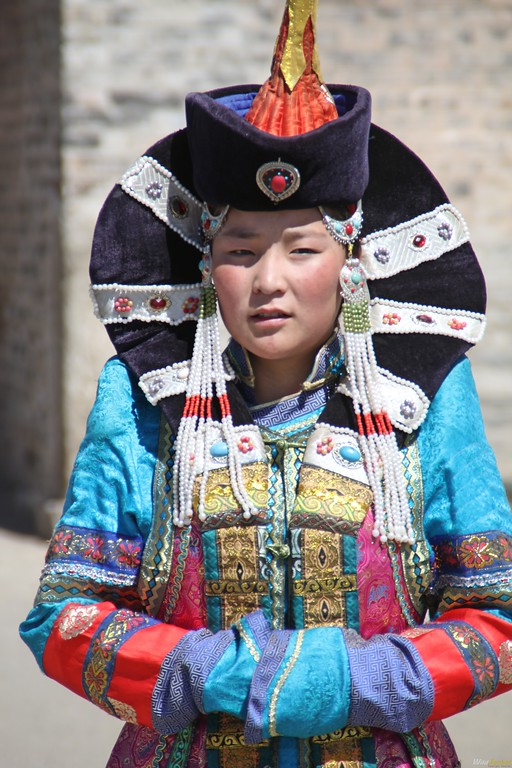 A Mongolian girl dressed up in traditional wear