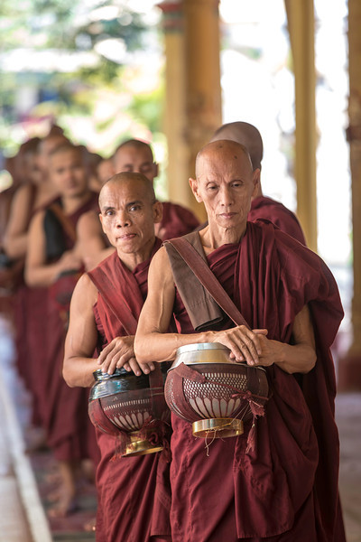 The monks in Mandalay line up in the morning for their daily meal. Some more anxious than others.