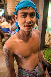 This young man was happy to show of his strength and tatooed arm in the marketplace