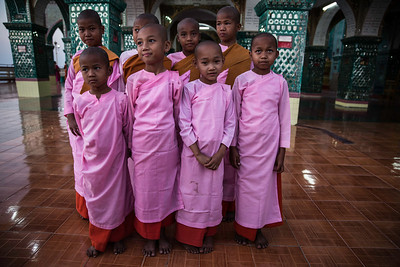 These young nuns were convinced to pose while visiting the mountain top overlooking central Mandalay.