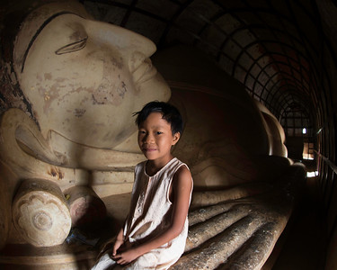 This young lady was happy to pose in a side temple with a long resting Buddha.  We bought her postcards for 1 and 1/2 times the going rate.  A deal.