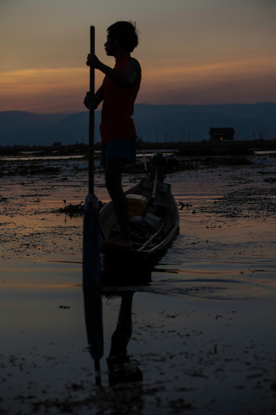 An inle lake fisherman silhouetted in the sunset..