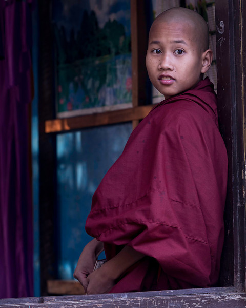This young monk was studying dutifully till he noticed me outside photographing him