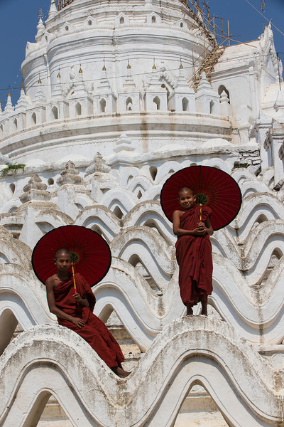 Monks posing on the white temple.  Here just resting with their umbrellas