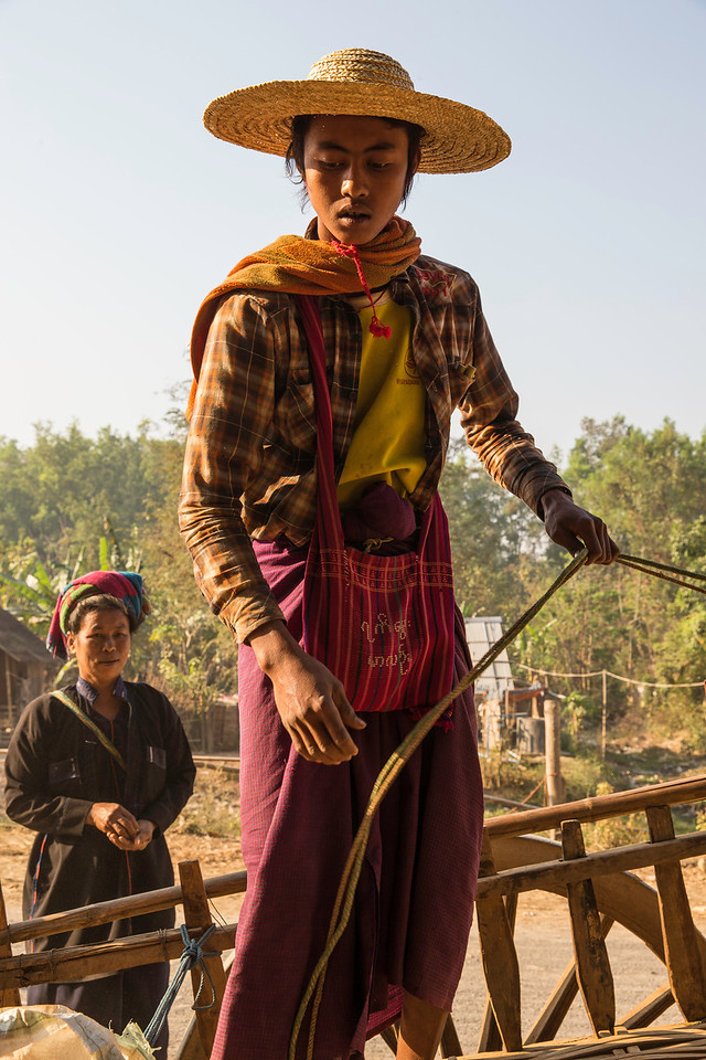 This young man stands on the back of his ox cart which moments ago was fully loaded with goods he delivered to the market.