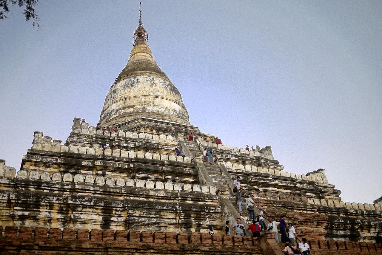 Tourists climb Shwesandaw Pagoda for sunset in Bagan, Burma (Myanmar)