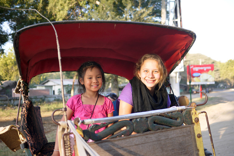 Ana and her friend M in the back of a horse cart in Bagan, Burma (Myanmar)