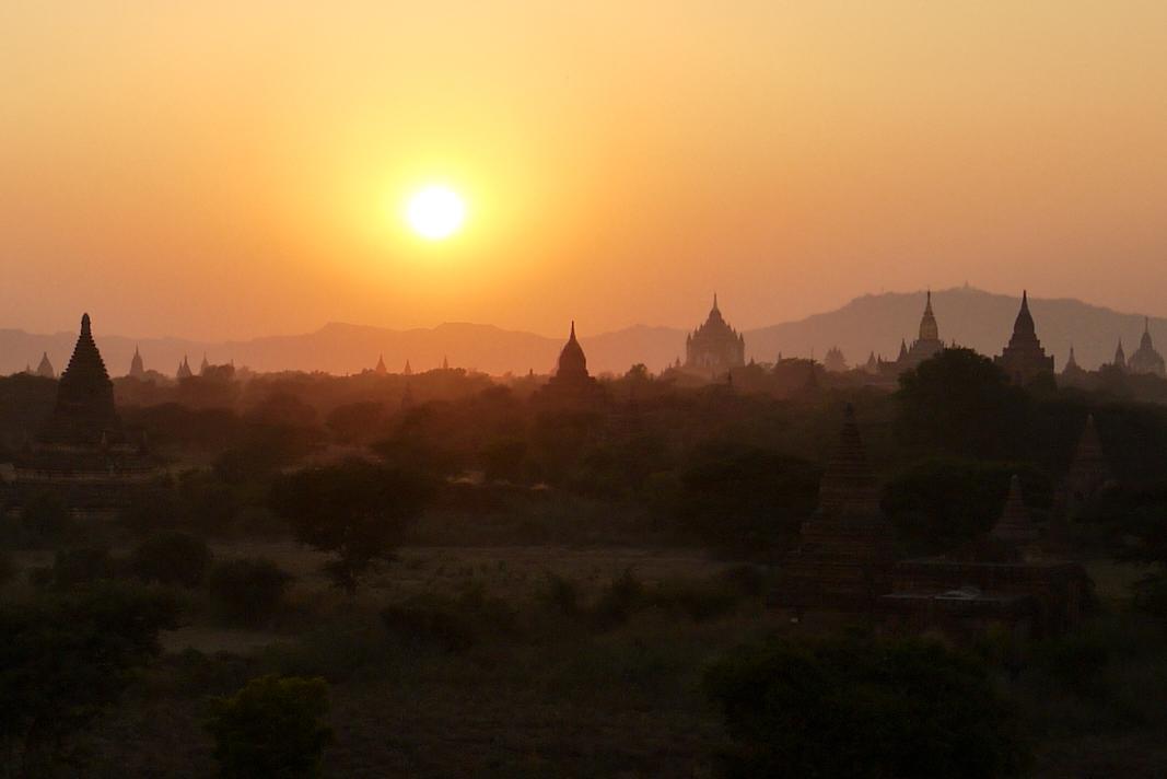 The setting sun and temple silhouettes in Bagan, Burma (Myanmar)