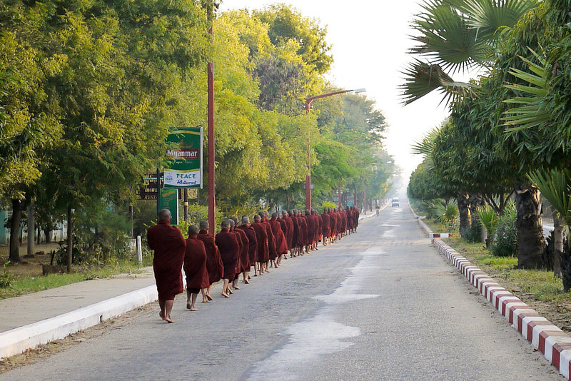 Monks line up for alms in Bagan, Myanmar
