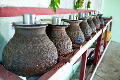 A watering station with cups and fresh water at the temple on the top of Mt. Popa Bagan, Burma (Myanmar)