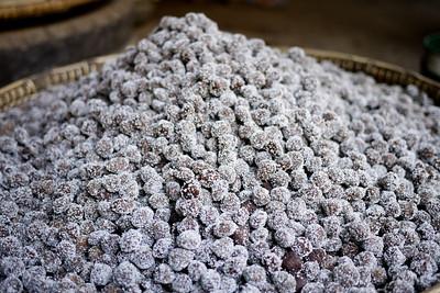 A pile of freshly rolled sour plum sugar candies in Bagan, Burma (Myanmar)