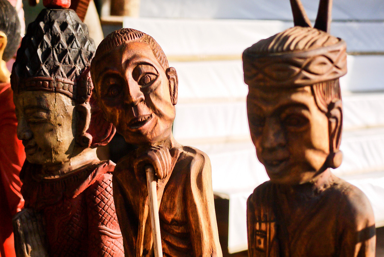 Carved faces lining the gift stalls in Bagan, Burma (Myanmar)