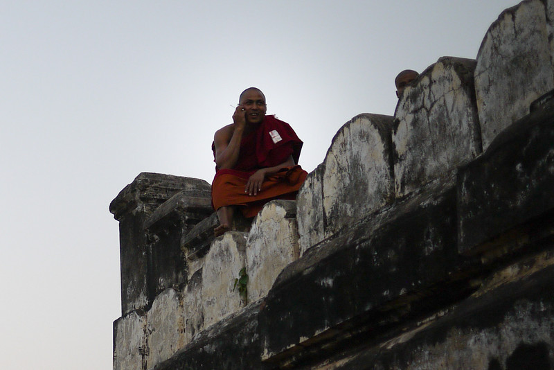 A monk on his cell phone in Bagan, Burma (Myanmar) on Shwesandaw Pagoda.
