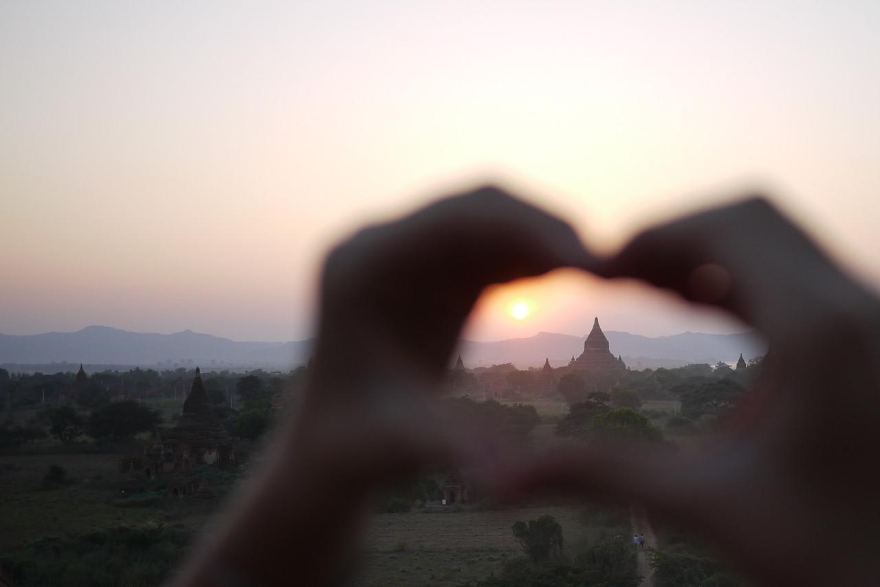 Ana makes a heart in the setting sun in Bagan, Burma (Myanmar)