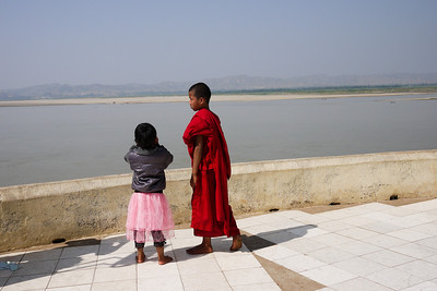A young monk on the banks of the Irrawaddy River from the Bupaya in Bagan, Burma (Myanmar)