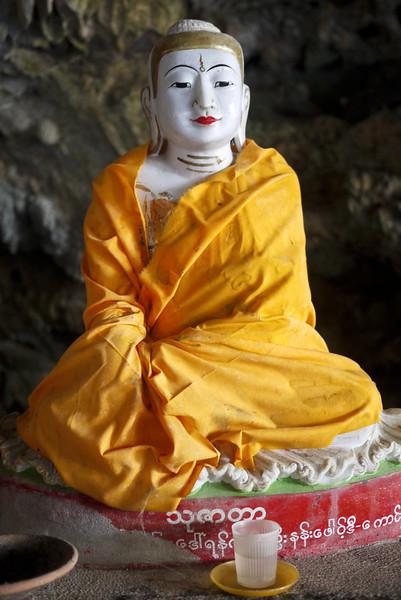 Buddha wrapped in saffron cloth in the Kaw Ka Taung Cave near Hpa-An, Burma.