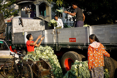 Vendors unload vegetables in Hpa-An, Burma.