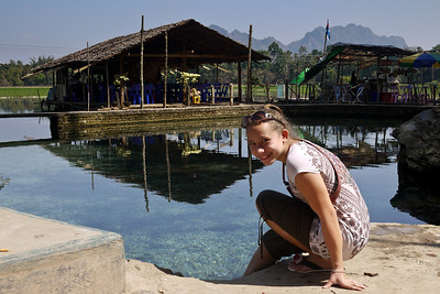 Ana tests out the cool waters at the swimming hole near Hpa-An, Burma.
