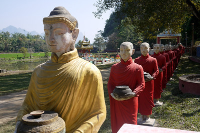 Dozens and dozens of monk statues line the rocks outside the Kaw Ka Taung Cave in Hpa-An, Burma.