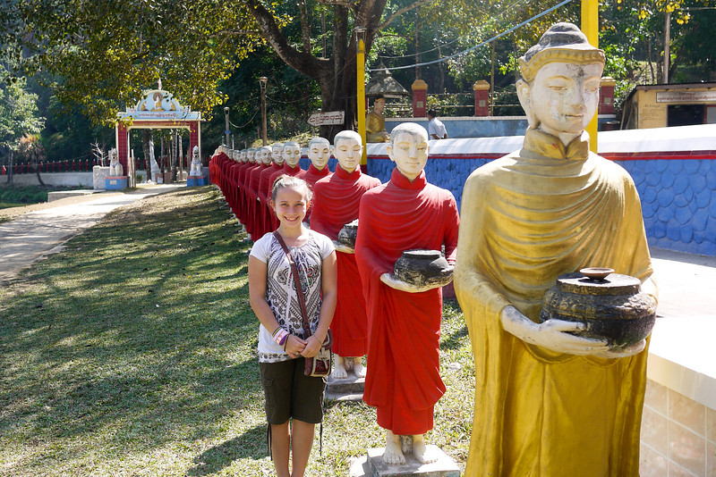 My niece Ana stands with the monks and rice alms bowls in the countryside near Hpa-An, Burma.