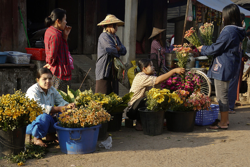 Flower vendors line the streets in Hpa-An, Burma.