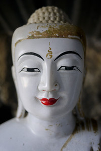 Buddha face, one of many lining the Kaw Ka Taung Cave in Hpa-An, Burma.